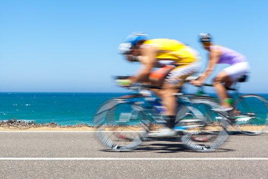 Cyclists competing along a coastal road