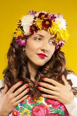 beautiful spring girl wearing flowers hat