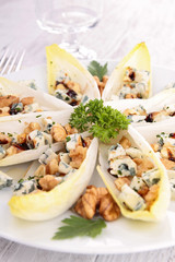chicory boats with cheese, walnut and honey