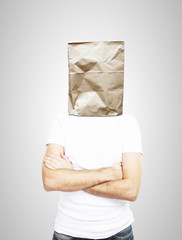 man standing with paper bag