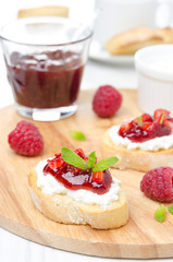 Toasted baguette with cream cheese and raspberry jam