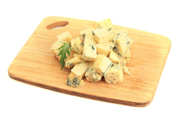 Tasty blue cheese on cutting board, isolated on white