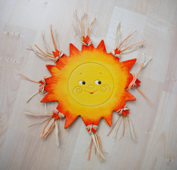Ceramic sun for hanging on the wall