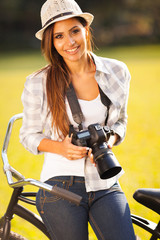 pretty woman with camera outdoors