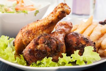 Chicken drumsticks with prepared potatoes