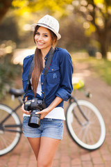 young girl posing with digital camera