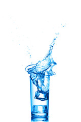 Water splashes in the glass on white background