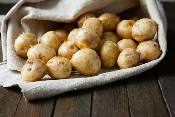 raw baby potatoes in a sack