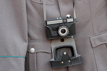 old camera and a military jacket