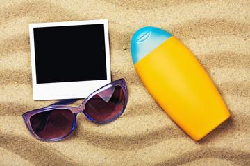 photo frame, sunblock and sunglasses