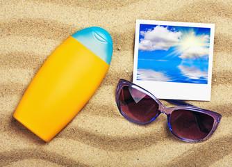 Photo of the sea, sun cream and sunglasses