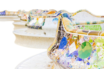 Detail of colorful mosaic in a bench of park Guell, isolated on