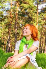 Happy woman in sunny park