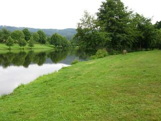 Tuinposter Rivier lac de barge