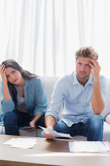 Anxious couple doing their accounts
