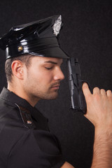 Young policeman looking down