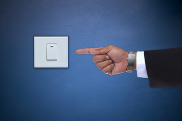 hand pointing to switch of electric appliance