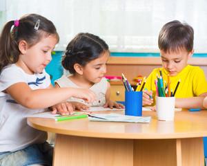Group of cute little prescool kids drawing