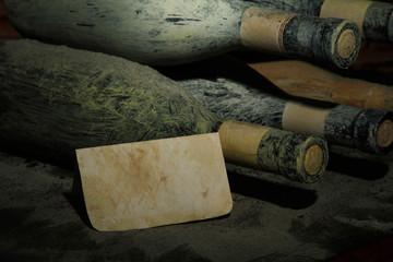 Old bottles of wine in old cellar, on dark  background
