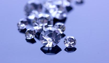 Beautiful shining crystals (diamonds), on purple background