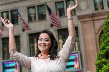 Happy young lady celebrates New York