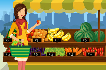 Woman shopping in an outdoor farmers market