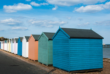 Colourful beach huts on sunny beach