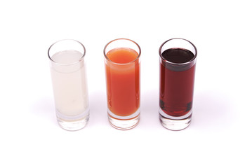 Three glasses with juice and tonic
