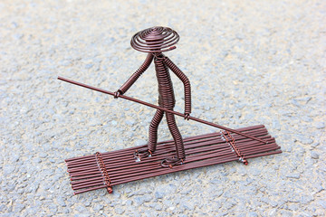 toy crafts boatman made of copper wire
