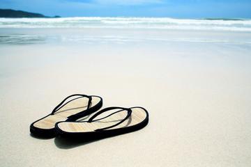 Flip flops on the sand on paradise beach