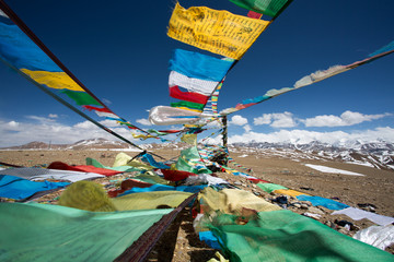 Prayer Flags and the range of Himalaya Mountains in in the backg
