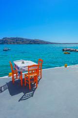 Fototapete - Greece Santorini island in Cyclades,  greek tavern concept by th