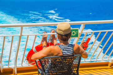 Fototapete - Tourist enjoyng the trip on greek ship during vacations
