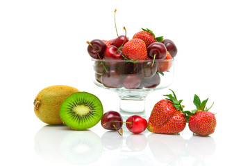 berries and fruits. kiwi, strawberry and cherry on a white backg