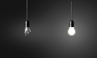 One broken and one glowing bulb. Idea concept