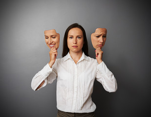 businesswoman woman holding two masks