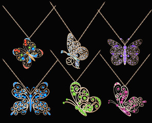 set of butterfly pendants with precious stones