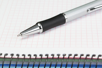Office supplies for an accountant. Ballpoint pen and notebook.
