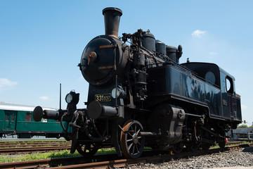 Vintage steam locomotive in station