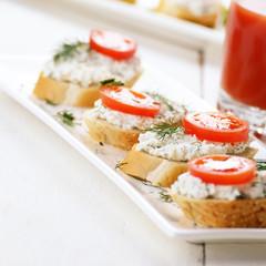 Breakfast of cottage cheese bruschettas and tomato juice