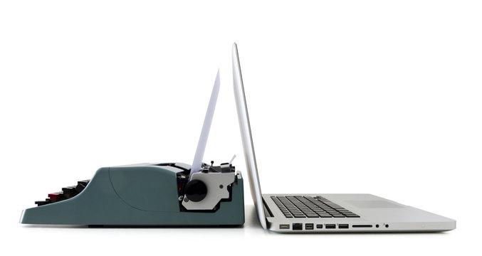 contemporary laptop vs old typewriter