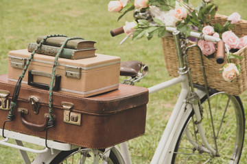 Printed kitchen splashbacks Bicycle Vintage bicycle on the field with a basket of flowers and bag