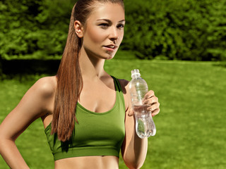 Beautiful Girl drinks Water after Yoga exercise