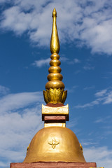 Thai chedi over blue sky