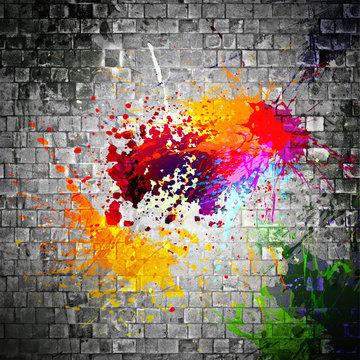ink splatter on stone wall