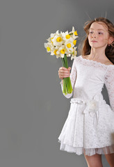 Girl in white dress with narcissus