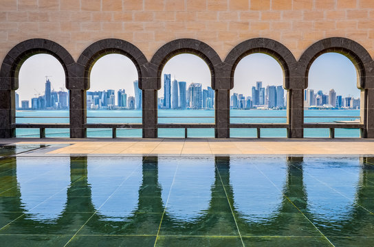 Doha skyline through the arches of the Museum of Islamic art, Do
