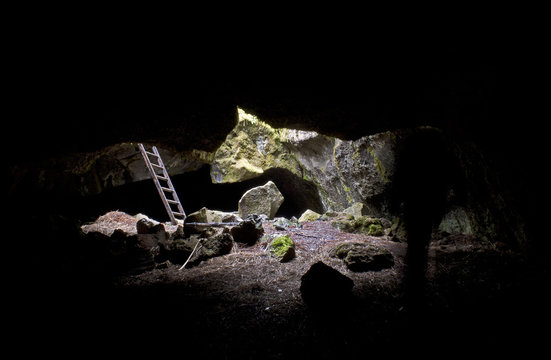 Ladder access for lava tube cave viewed from inside