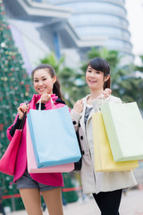 happy Chinese women go shopping