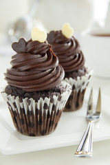 Chocolate muffins with chocolate cream.